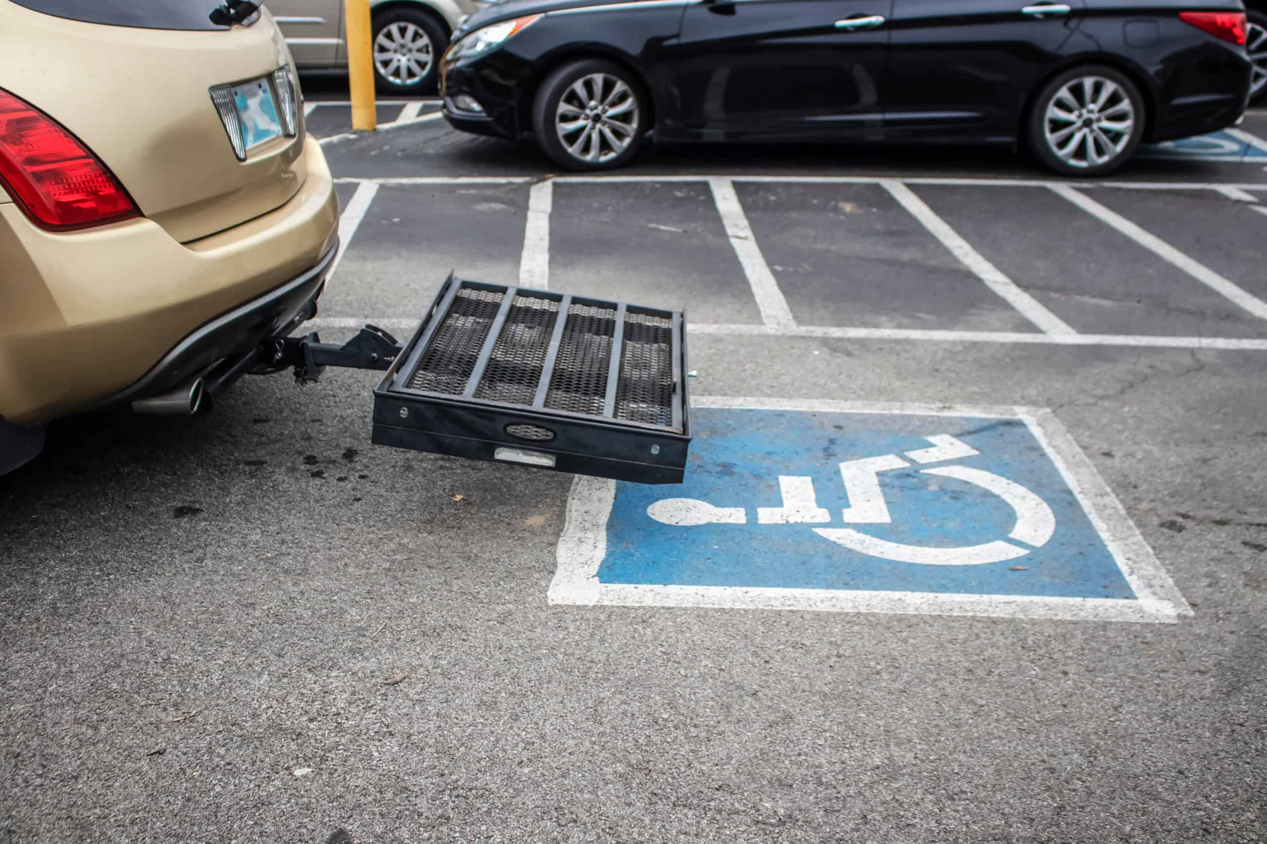 Wheelchair Carrier for Car in handicapped parking space in parking lot