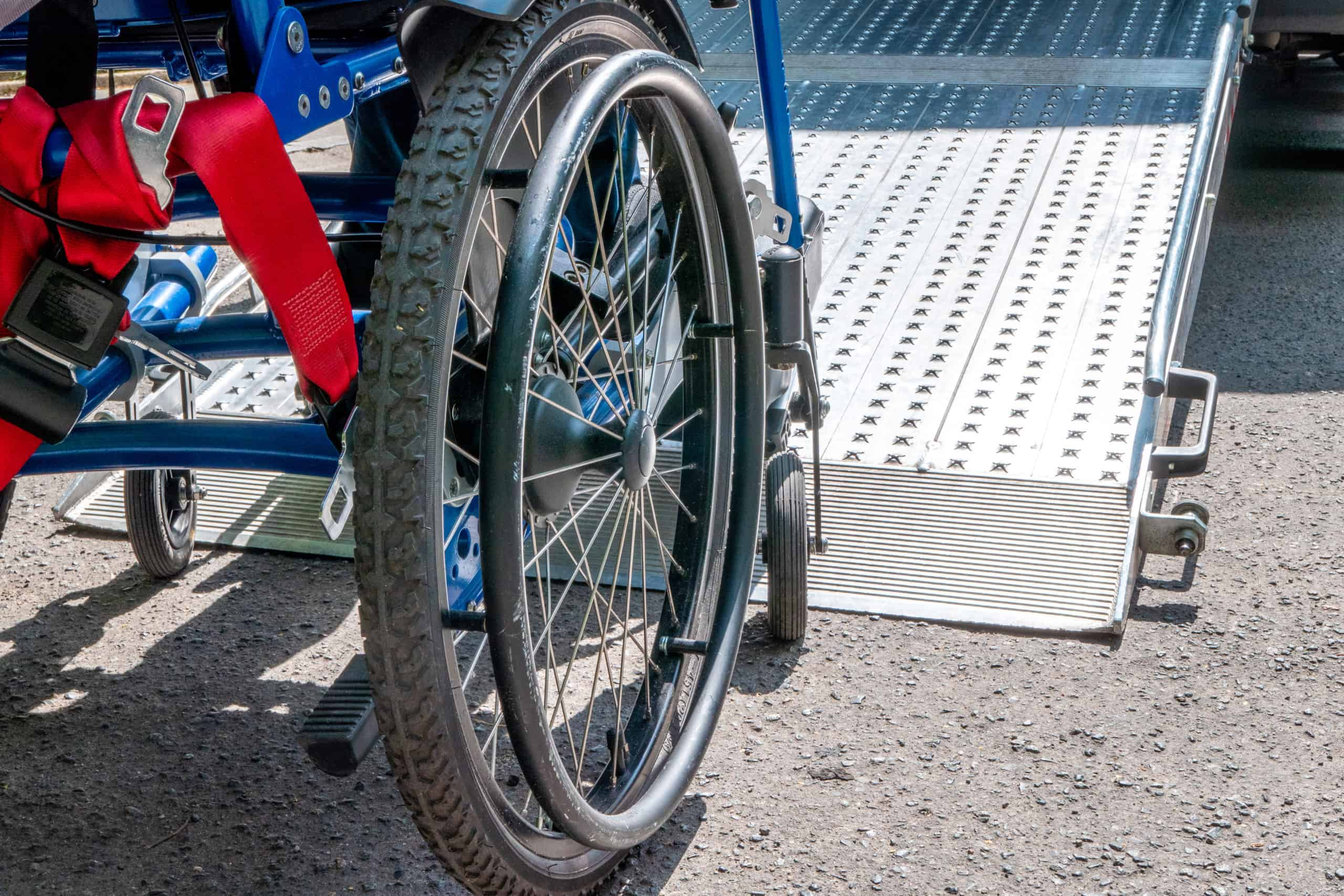 A wheelchair in front of a vehicle ramp